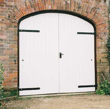 White curved top solid garage doors