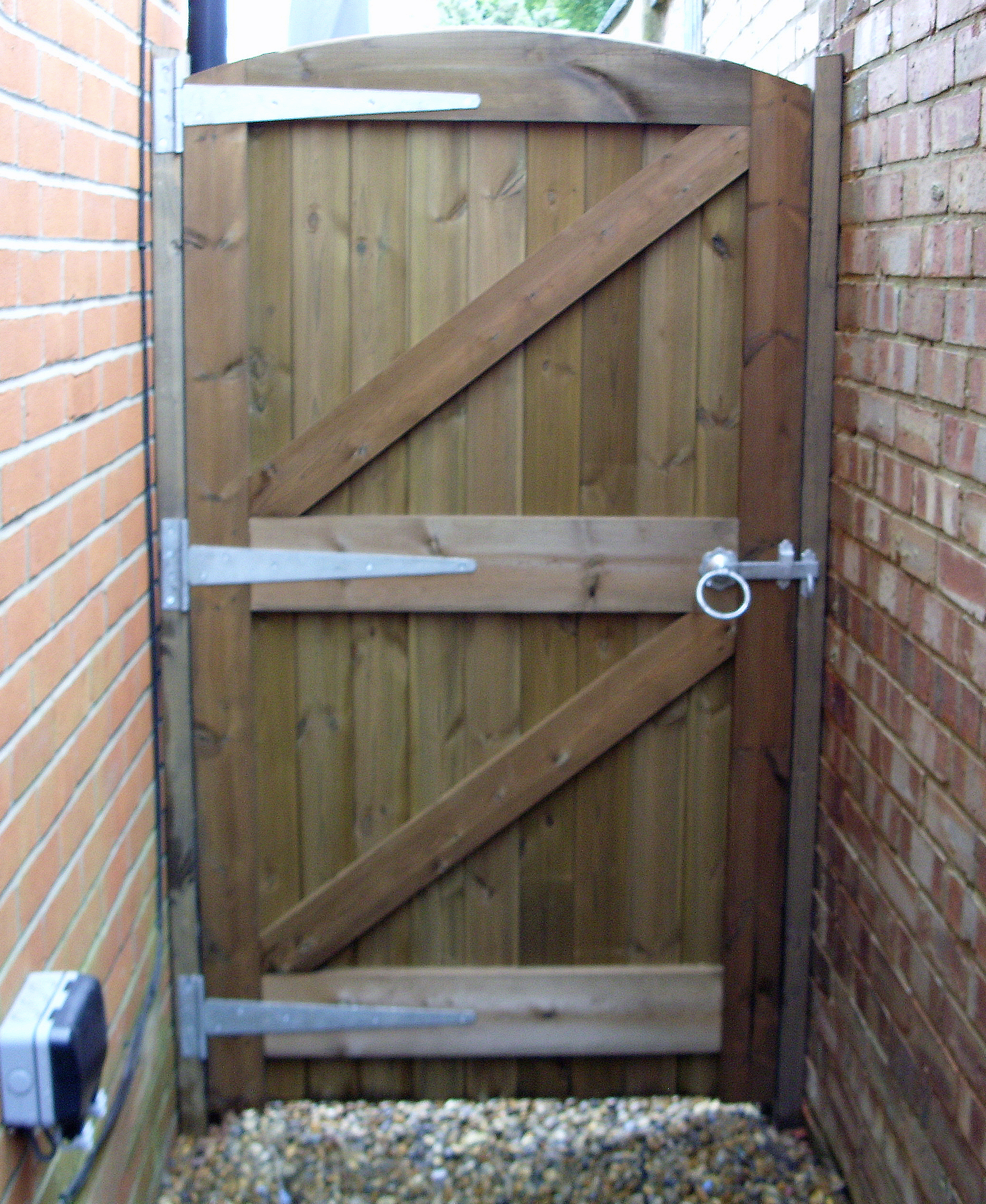 Reverse of Kentwell gate no raised manors in brown pressure treated